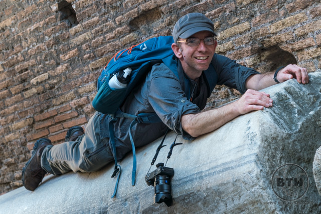 Aaron hanging on a column in the Colosseum in Rome, Italy
