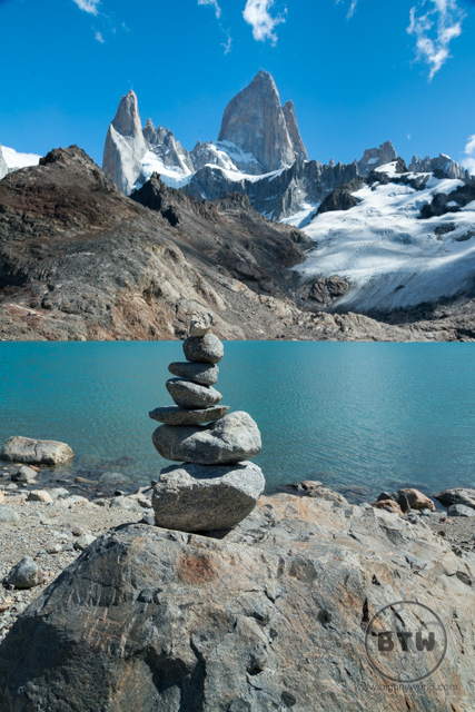 A cairn in front of the peaks of Fitz Roy in Argentina