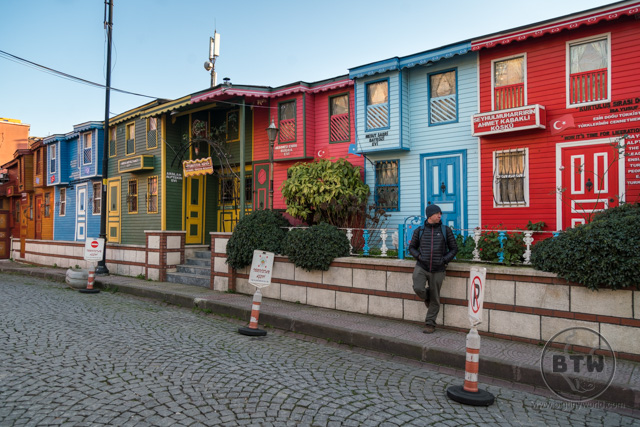Aaron standing in front of colorful buildings in Istanbul, Turkey