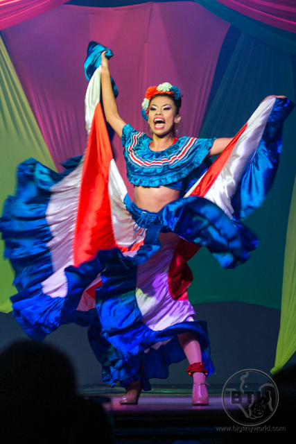 A dancer in a red, white, and blue dress during a show at the Doubletree Resort in Puntarenas, Costa Rica | BIG tiny World Travel