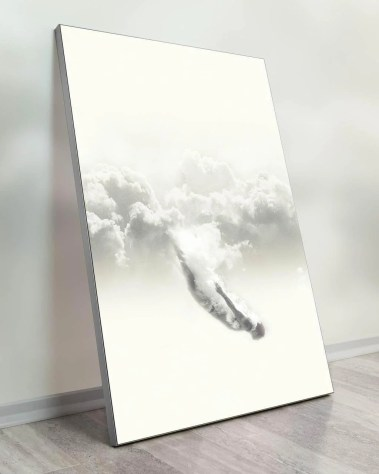 Oversized woman diving into a sea of clouds wall decor