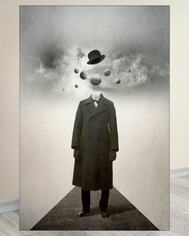 Oversized black and white wall decor of a man walking on a road with a top hat and planets spinning around his head