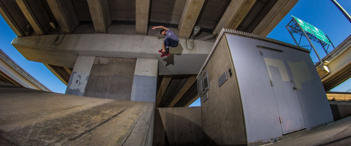 Mick Casals lacing an air off building