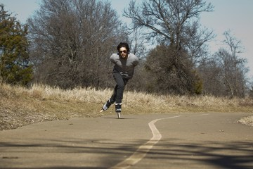 Fritzer owner of Carriers skate shop skating on the trail