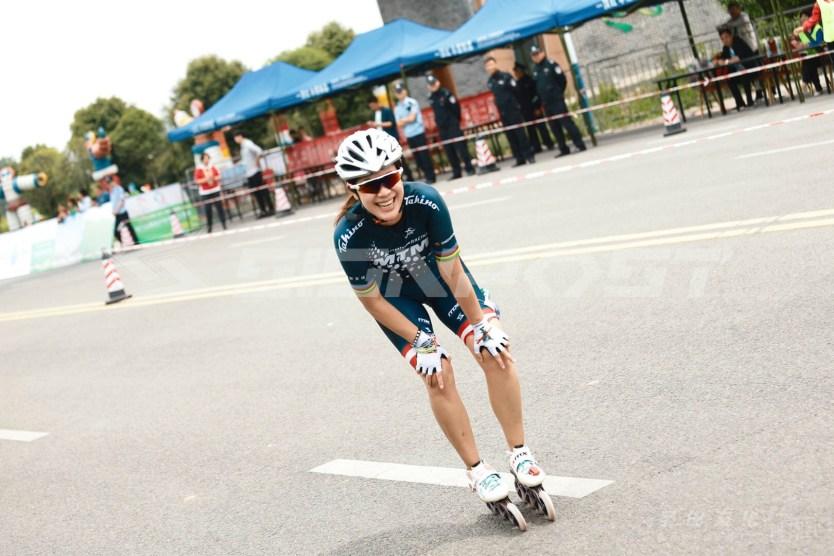 Angie rolling up to the finish line of the Pengzhou International Marathon