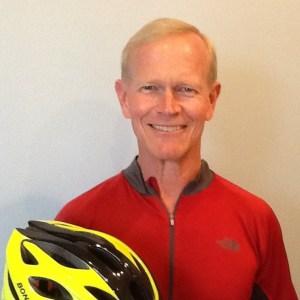 Steve holdling a bike helmet