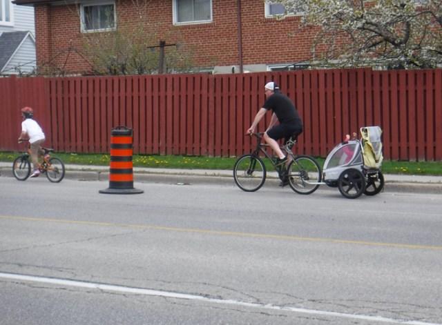 parent, bike trailer, children COVID lane