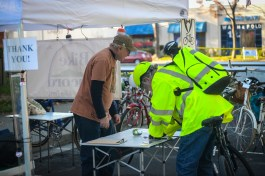 BC organizer David Schomaker supervises the bike valet tent while Concord Planning Commissioner Ray Barbour checks in his bicycle.