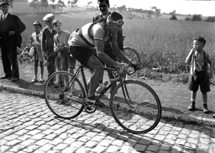 Frenchman RenÈ Vietto rides on the cobblestones during the 2nd stage of the Tour de France between Lille and Brussels (Belgium) on June 26, 1947. Vietto, along with a few other riders, including the leader Ferdi Kubler from Switzerland, left almost right from the start before riding on a lone breakaway of more than 130 km on his way to winning the stage and taking the overall leader's yellow jersey. (Photo credit should read -/AFP/Getty Images)