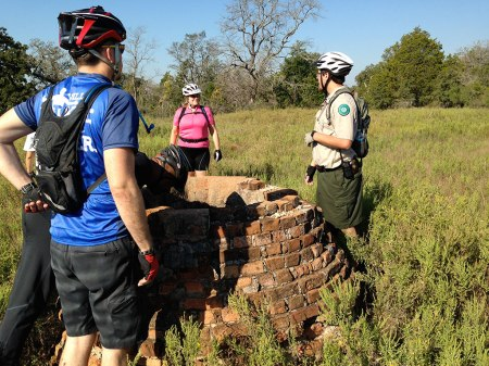 Ranger Mick answers a question from Maggie at the remains of the town cistern in what used to be Yewpon, Texas.