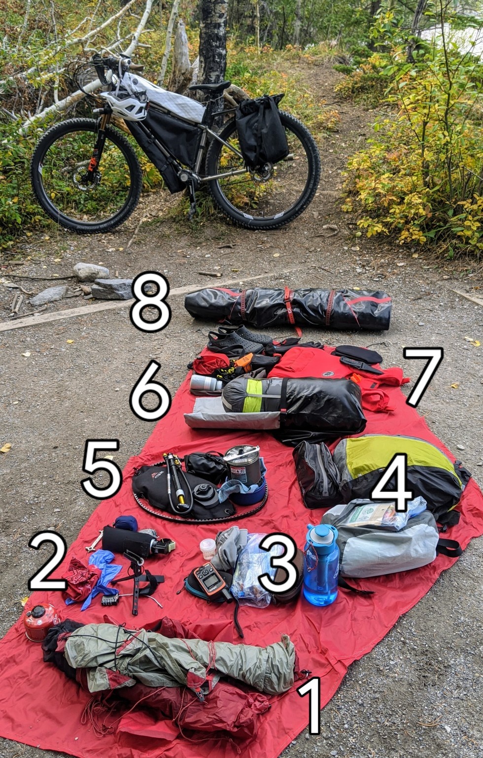 All gear laid out on a DIY tent footprint.