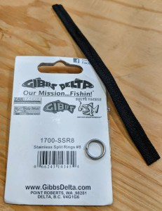 """#8 stainless steel split rings from a fishing supply house are the appropriate size for the MSR Hubba composite pole ends. Pictured with one of the 5"""" lengths of triple-sewn grosgrain."""