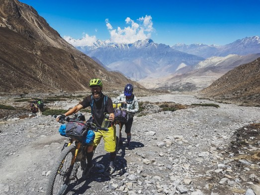 Pushing bikes to high camp. Muktinath, Nepal