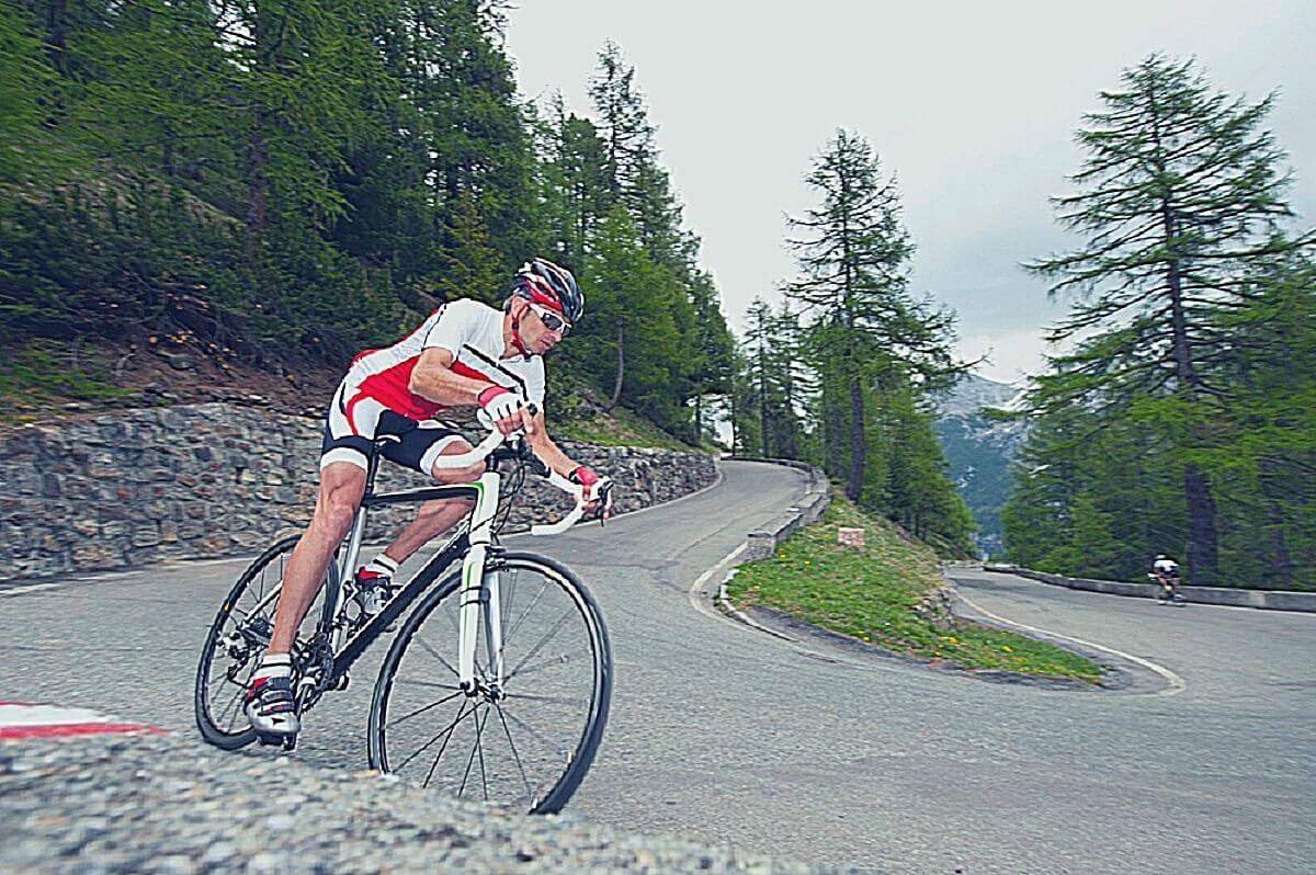 Cyclist riding downhill on a road bike