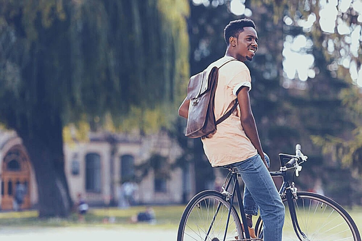 student outside college on a bike