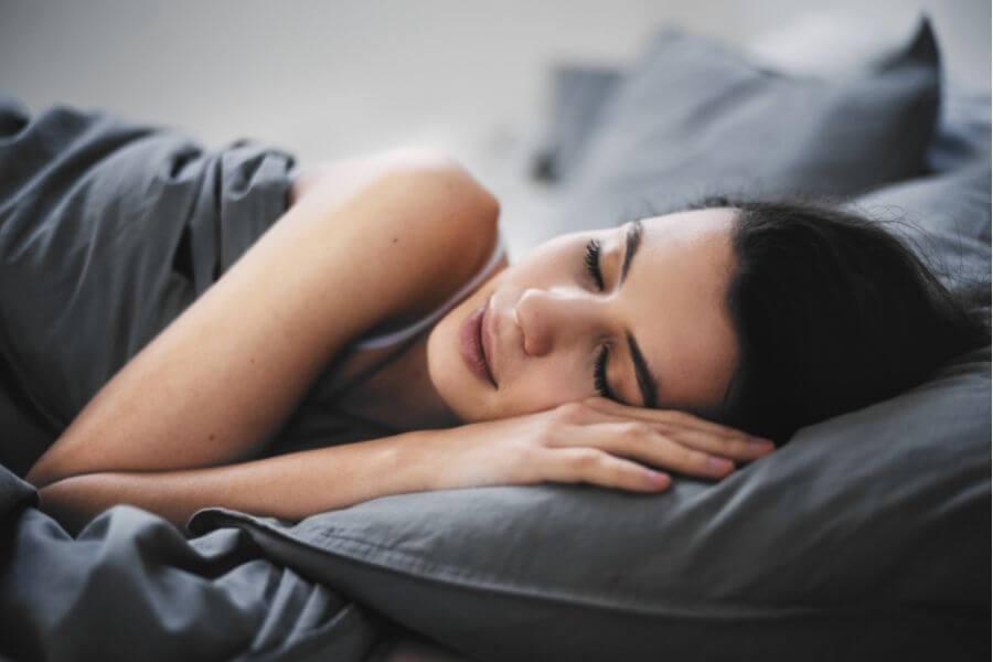 Female lying down in bed sleeping