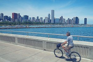 senior cycling at beachfront in Chicago, Illinois