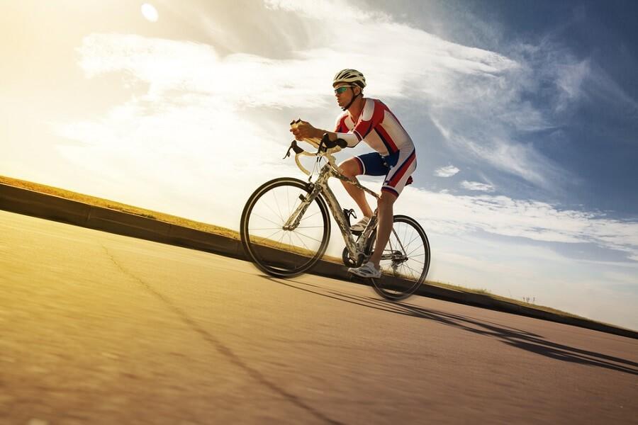 Man riding bike hard in the heat