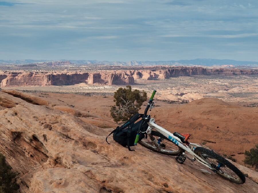 bicycle with backpack leaning against rocks in Slickrock trail, Moab - Flickr image