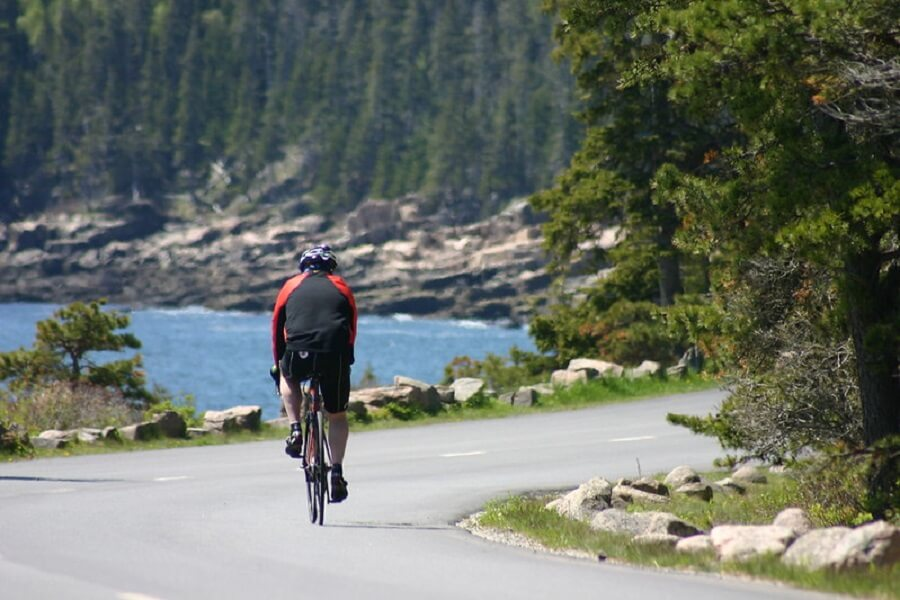 male cyclist bikes the 27-mile Loop Road in Acadia National Park - Flickr image