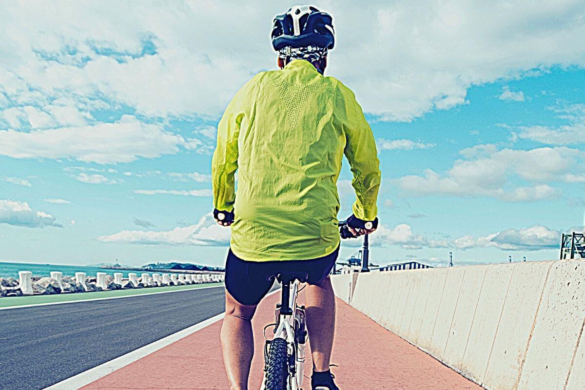 Man riding a bicycle on bike lane