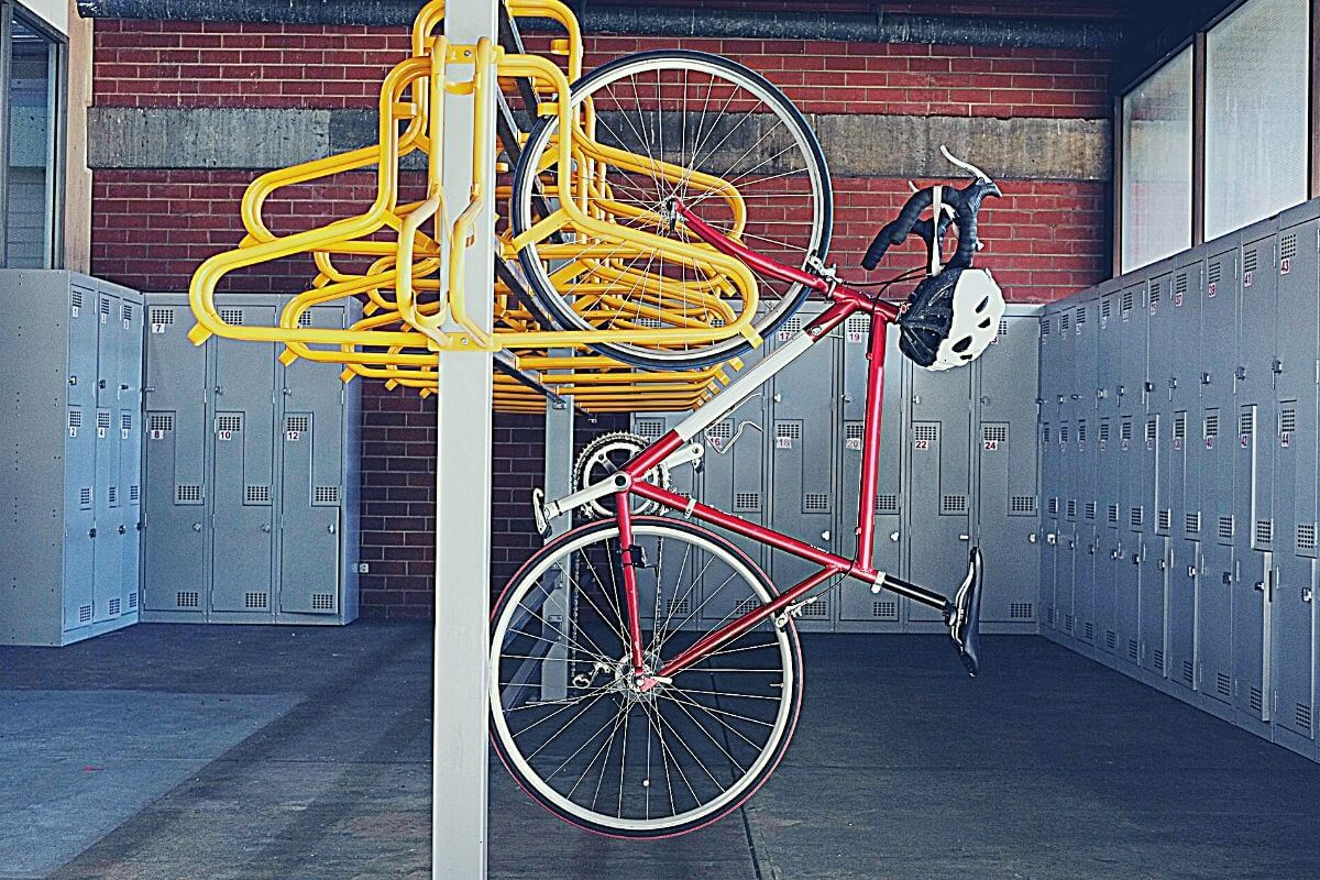 retro bike hanging inside a secure bicycle enclosure with lockers