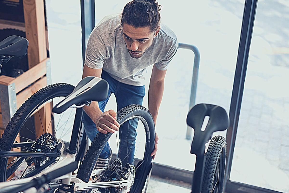 man inspecting bike seat in a shop
