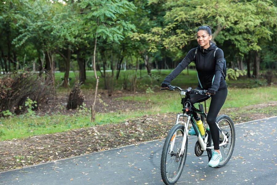 Healthy fit woman riding a bike