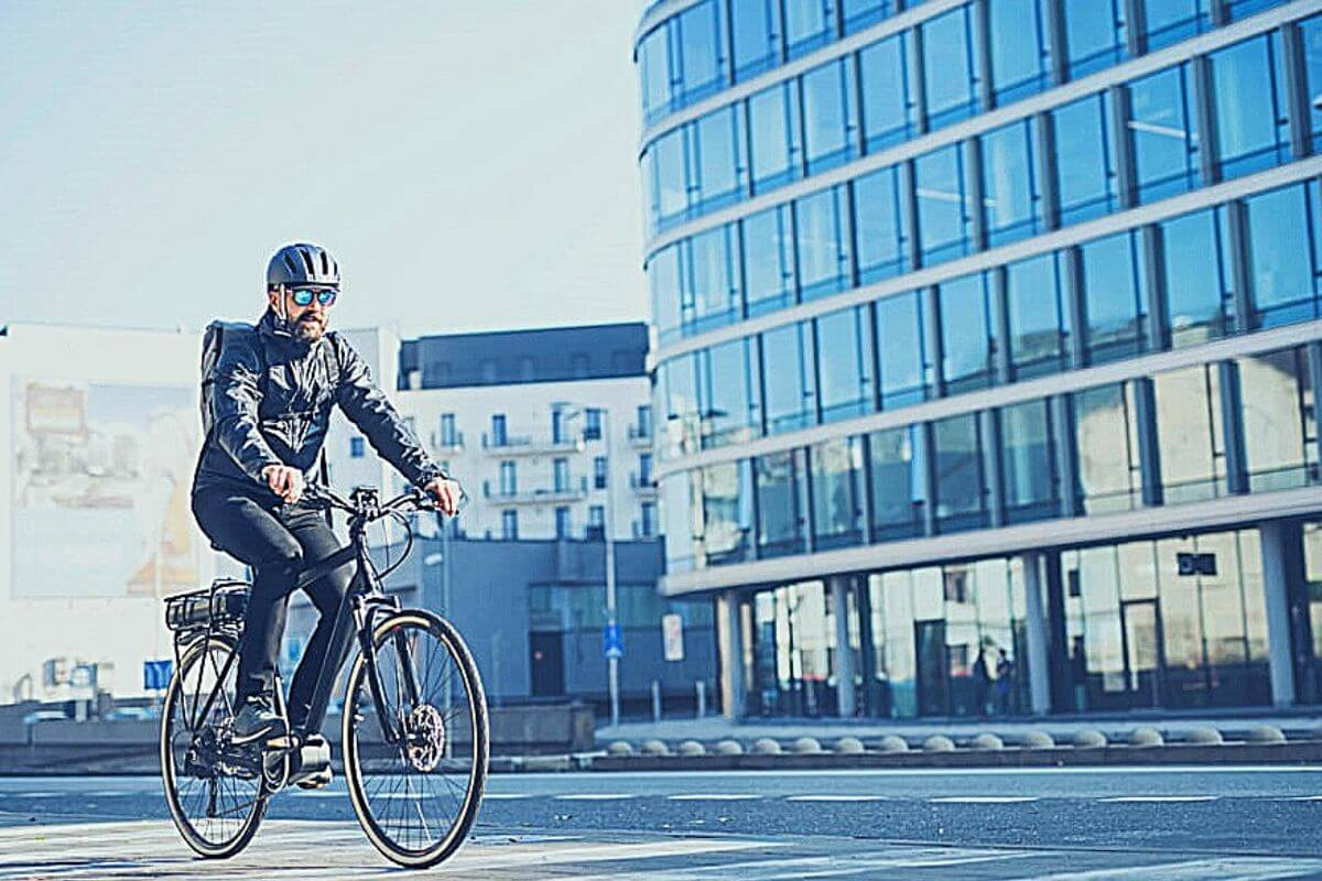 Man riding to work on a sunny day