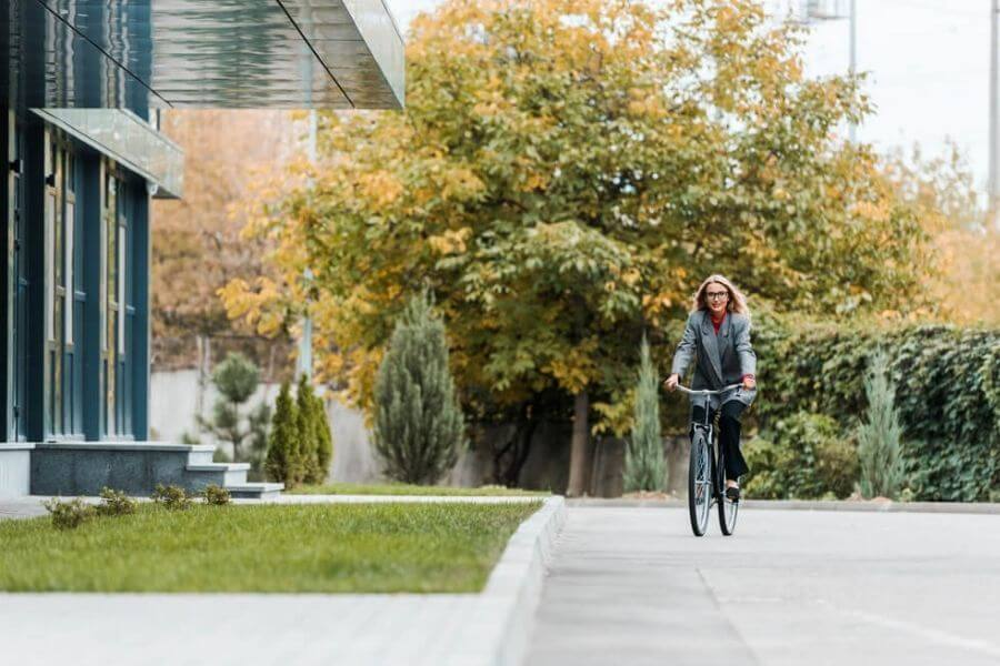 Woman arriving at work on her bicycle