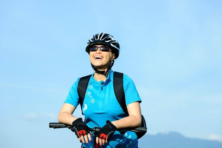 Stress-free woman on bike wearing complete accessories