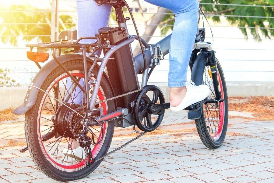 Female commuter riding on electric bike