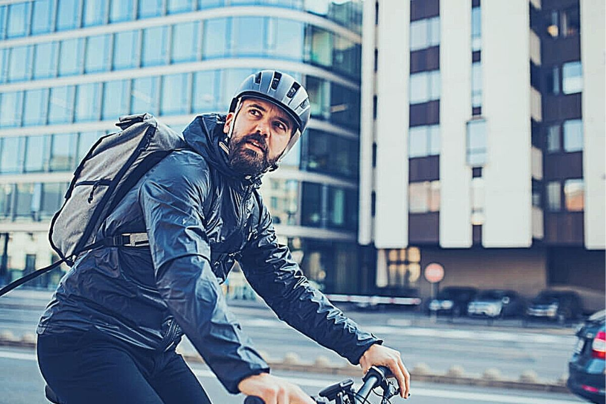 Commuter in cycling gear with backpack on