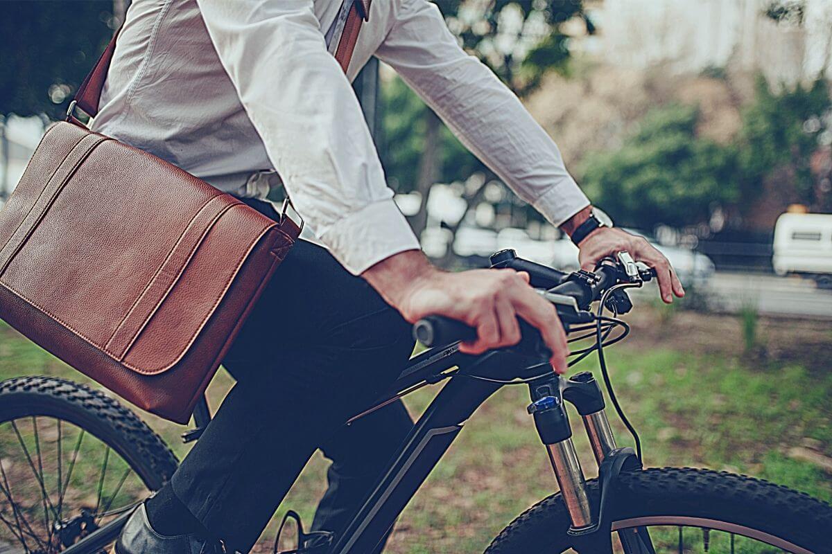 man commuting to work by mountain bike