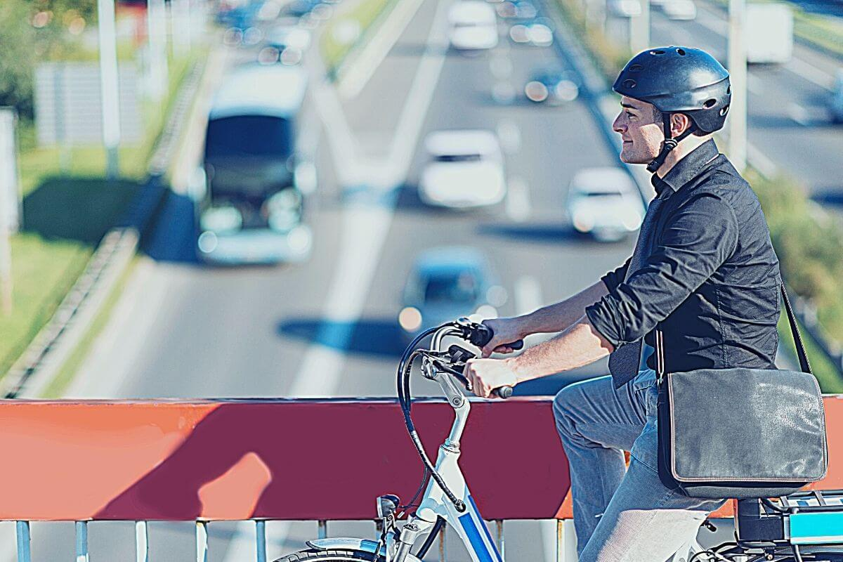 man commuting to work by bike in the morning