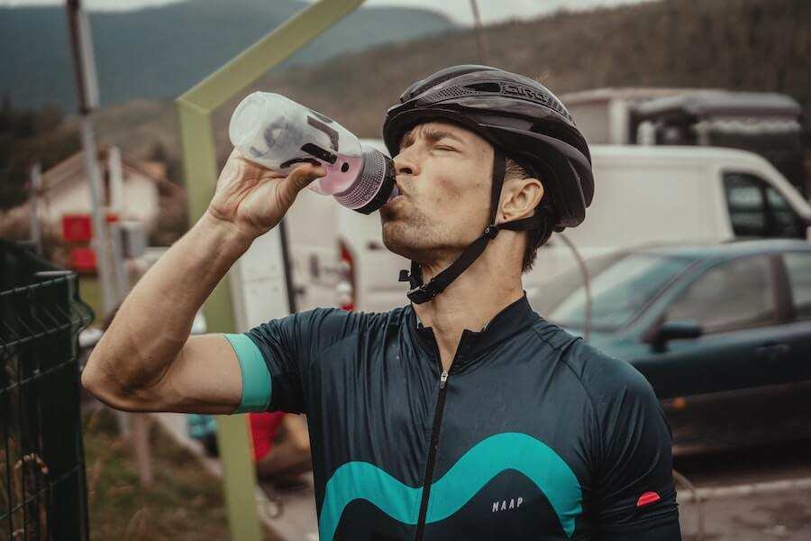 Cyclist Drinking Water From a Bidon