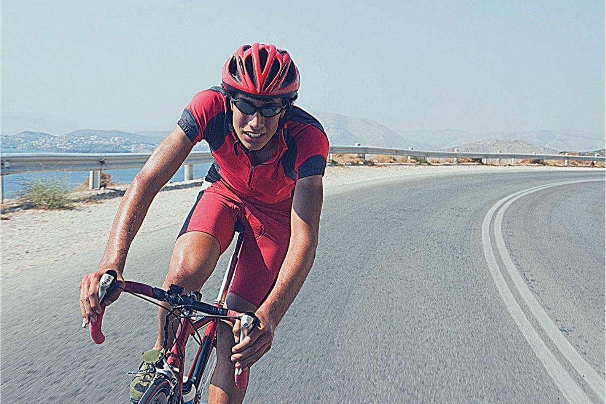 Cyclist training very hard on his bike