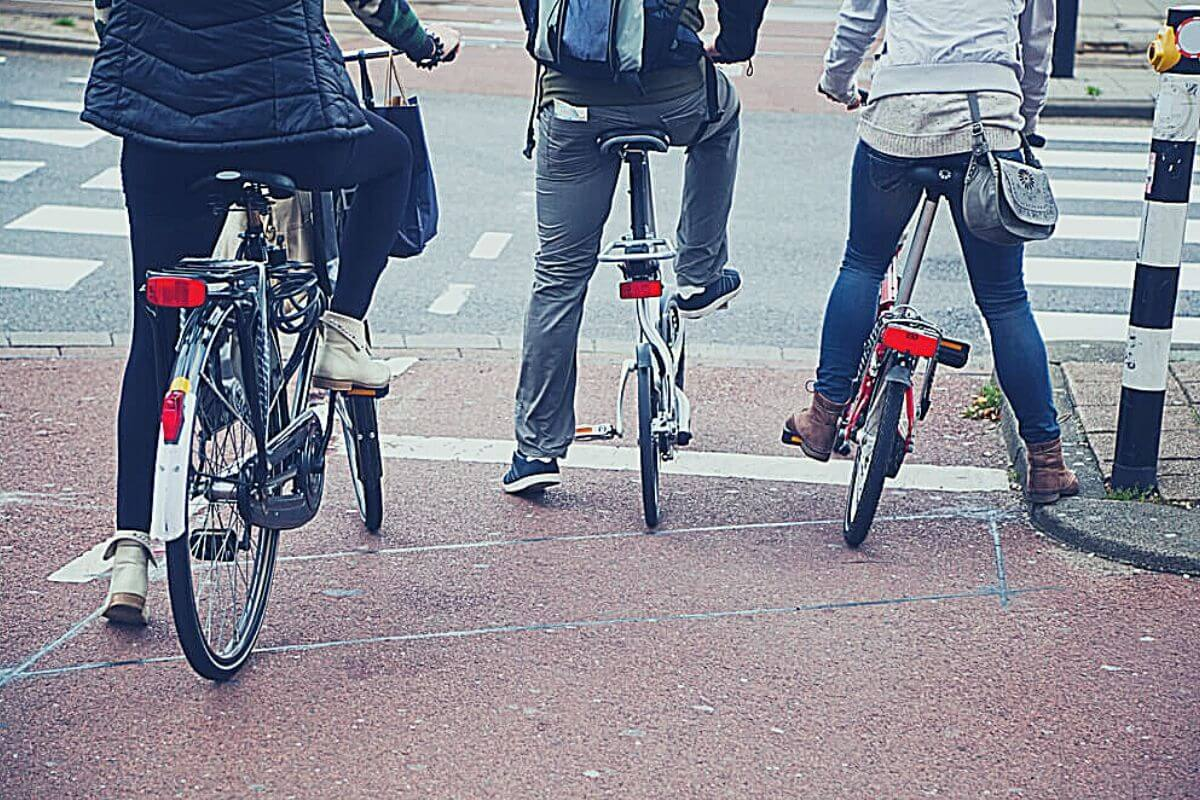 Bike commuters on their way to work waiting at a junction