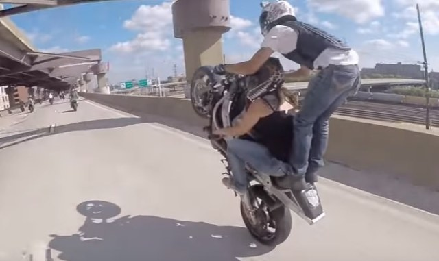 Motorcycle Hits Concrete Wall Riding Wheelie On Highway