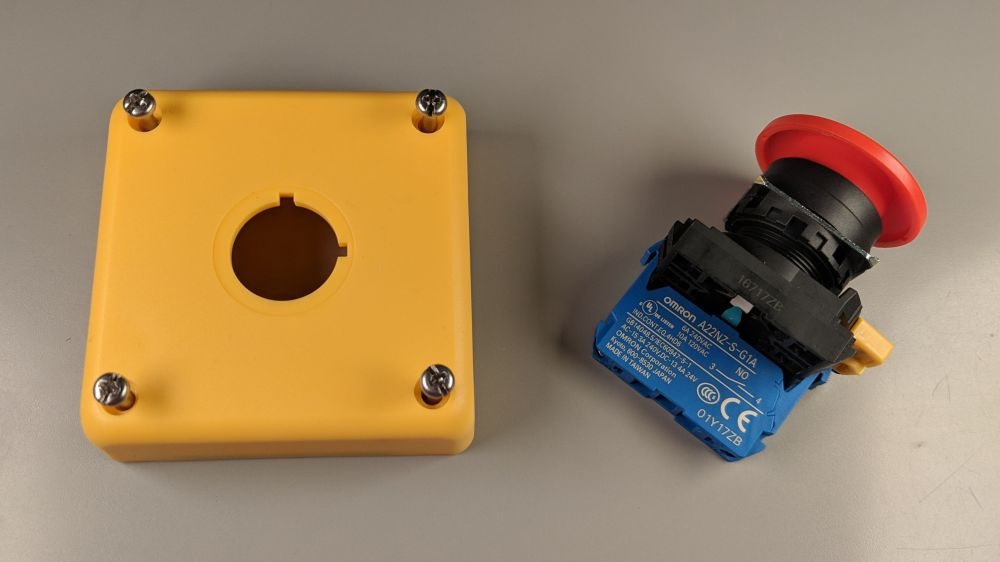 medium resolution of the lid of the enclosure and pushbutton switch with mushroom operator