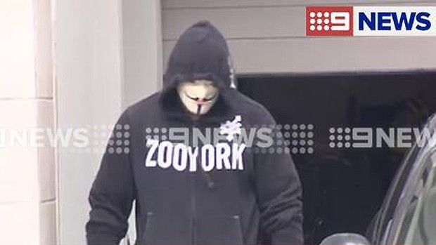 Ex-Bandido Jacques Teamo is evicted from his Varsity Lakes home wearing a Guy Fawkes mask.