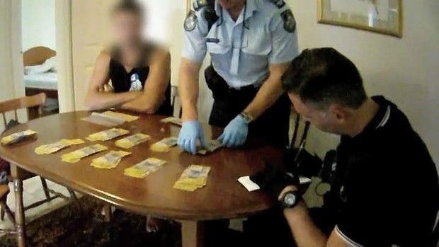 Police at Algester seize cash, drugs, alleged fake IDs during raid on man linked to Bandidos bikies