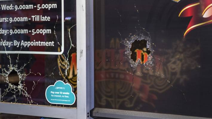 Three bullet holes, which appeared to be from a shotgun, were visible from the front of the tattoo parlour on Wednesday morning.