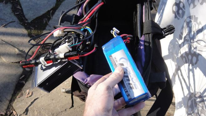 "Originally I built a 15-pound lead-acid battery (described in a previous post) for Thea's bike. This fall I began experimenting with lithium polymer (""lipo"") batteries, the same type of battery used by Radio Control enthusiasts. Not only are lipo batteries lightweight and inexpensive compared to my LiFePo4 and lead-acid batteries, they have a much higher discharge rate. This makes it possible to have a very small battery that can output enough amps to propel an ebike. So on Thea's bike I replaced the three heavy 12v 10ah lead-acid batteries in series (a 36v battery) with two lightweight 18.5v 3ah lipos in series (for a 37v battery). Here's the score: the lead-acid battery is 15 pounds, $100, 360wh, with a 36 mile range. The lipo battery is 2 pounds, $50, 108wh, with a 10 mile range. Which is better? It depends. My bike needs more range and weight is not a problem, so lipos are not a good option for me. But for Thea's bike the lipo's low weight is very appealing and their short range is not a problem."