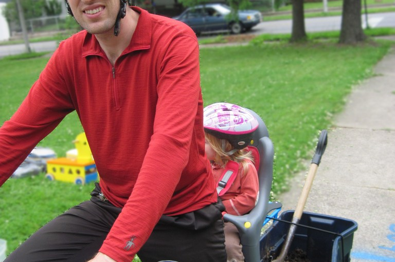 baby + tub o' compost on an electric cargo bike