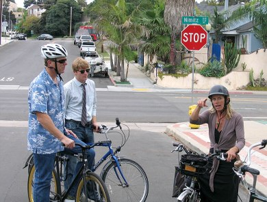 Councilmember Faulconer (in Hawaiian shirt), Council representative Michael Patton (with tie) listening to founder of District 2 bike/ped working group, Nicole Burgess, explain exactly why Nimitz Boulevard could become safer with some design treatments.