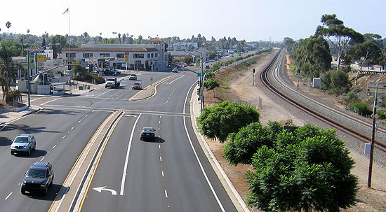 A view from the Clairemont Drive bridge looking south along Morena Boulevard. The proposed Trolley Station will be this side of Ingulf Street, at the light and crosswalk right where the tracks bend, and will be right up close to Morena Boulevard. photo: Kelly Cummings