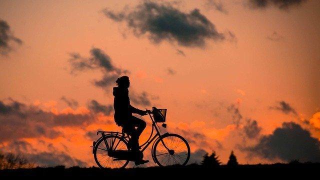 Cycling woman enjoying life