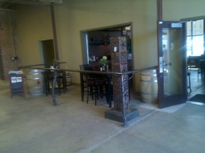 A large metal sculpture by Lyn's Metal Arts adorns the entrance to Market Place Wine Bar, Spokane, WA.