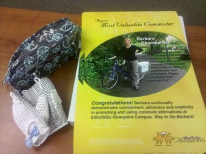 Spokane County Commute Trip Reduction poster showing Barb Chamberlain as Most Valuable Commuter, August 2011; Po Campo purse; Ana Nichoola bike gloves.